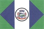 A Bandeira foi idealizada por Rudi Vogt, membro da comunidade local através de concurso público, sofrendo adaptação de Reynaldo Valaski, heraldista e vexílogo.