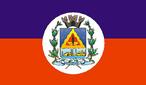 A bandeira criada através da Lei Municipal 511/77, possui dois retângulos, onde o azul representa o céu e o vermelho, a terra roxa de nosso município. No Centro, o brasão, dentro de um círculo, complementa a bandeira de Sertanópolis.